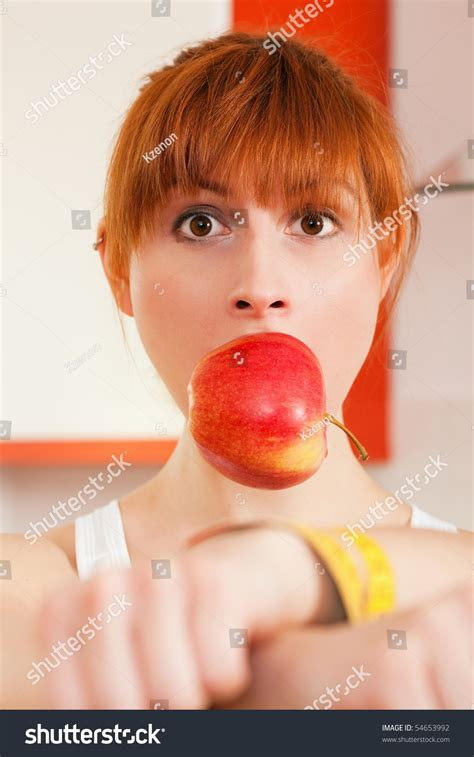 Woman Handcuffed By A Tape Measure And Gagged By An Apple