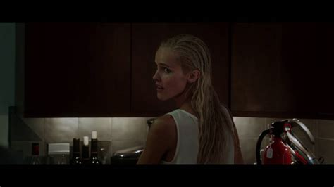 Nick Jonas Lifts His Shirt for Isabel Lucas in 'Careful