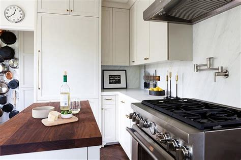 Light Grey Shaker Cabinets with Antique Brass Knobs
