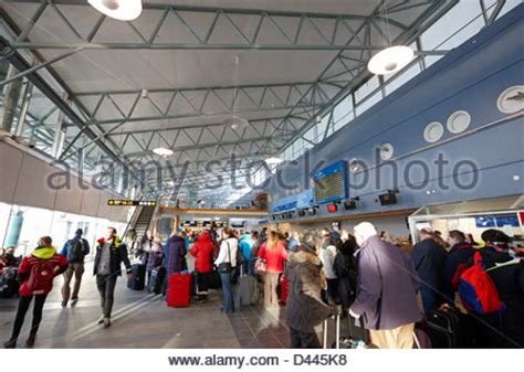 Passengers queuing to check in for departures at Tenerife