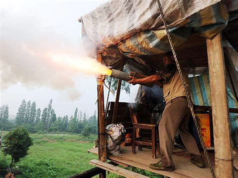 Chinese farmer uses cannon, fireworks to defend home from